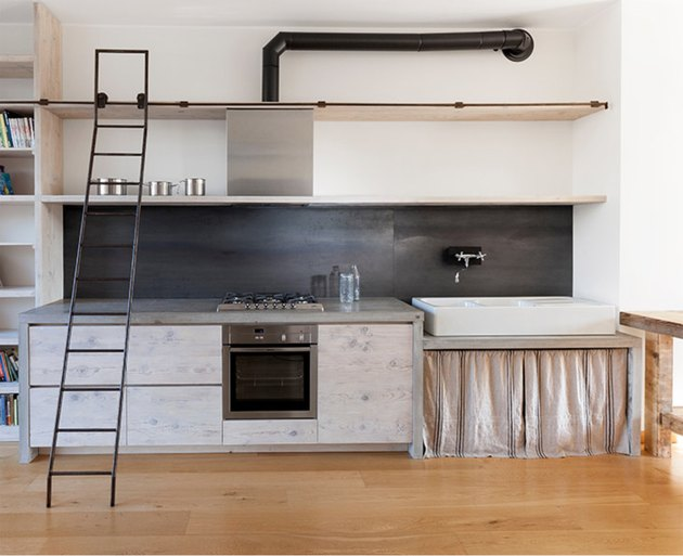 Kitchen with Concrete waterfall countertop by Katrin Arens