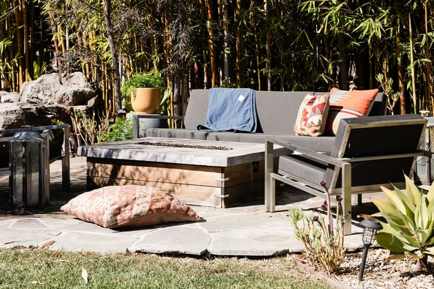 Outdoor idea with stone patio design with upholstered outdoor furniture and bonfire pit