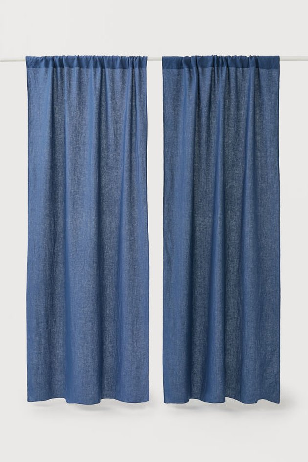 two linen blue curtains