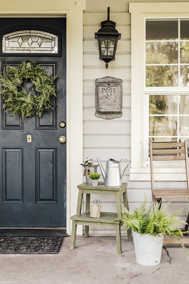Farmhouse front door idea in navy with greenery and farmhouse decor ideas