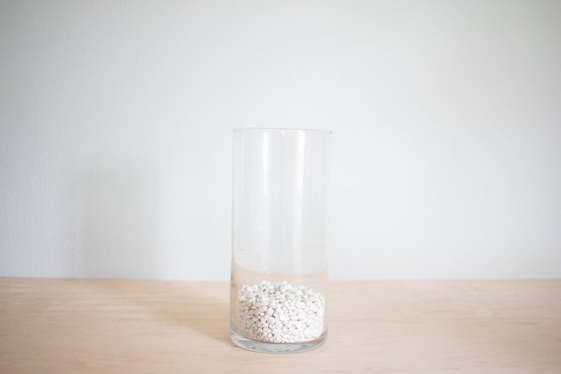 Gravel added to vase