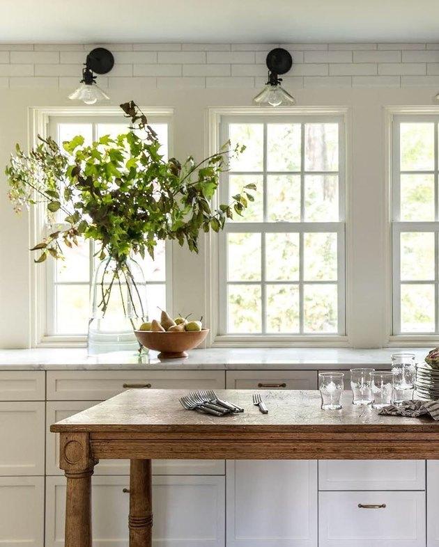 white kitchen with antique kitchen island