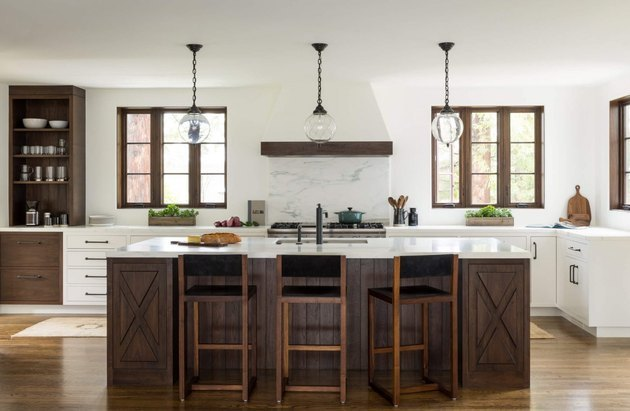 white kitchen with espresso kitchen island