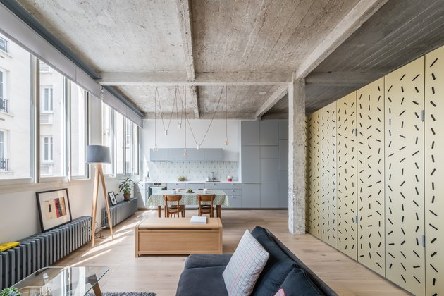 living room with cement ceilings