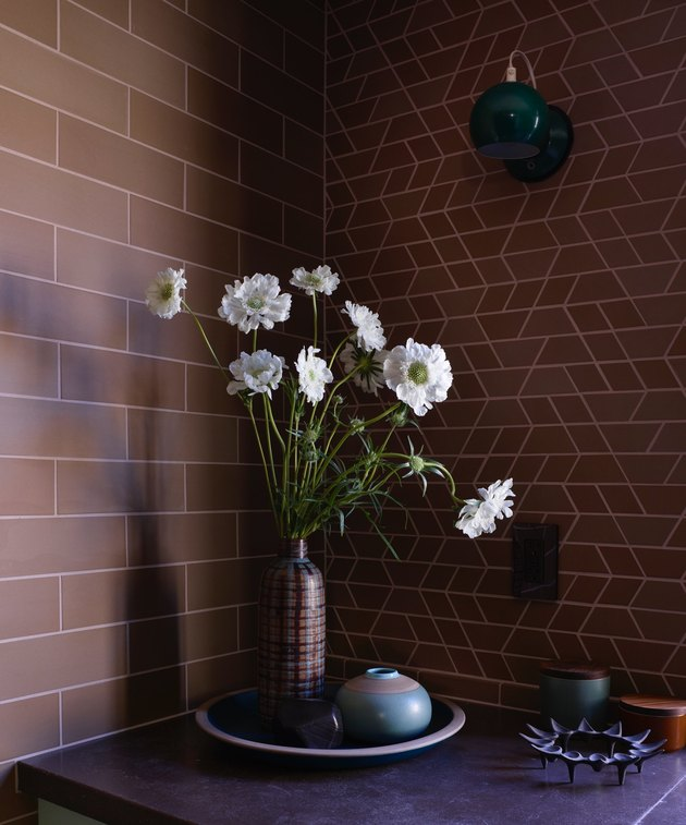 Two kinds of brown Heath tile in kitchen with Heath ceramics and flowers