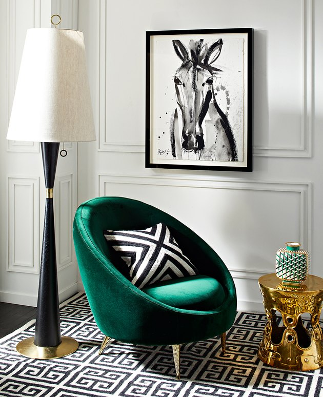 art deco living room with emerald green lounge chair in black and white room