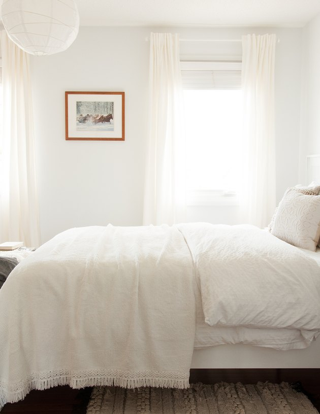 white bohemian bedroom with white curtains and linen