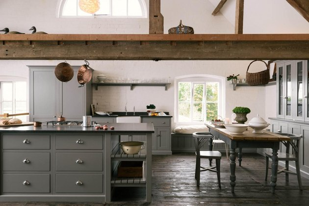 rustic farmhouse with dark kitchen floors of reclaimed wood and exposed ceiling beams