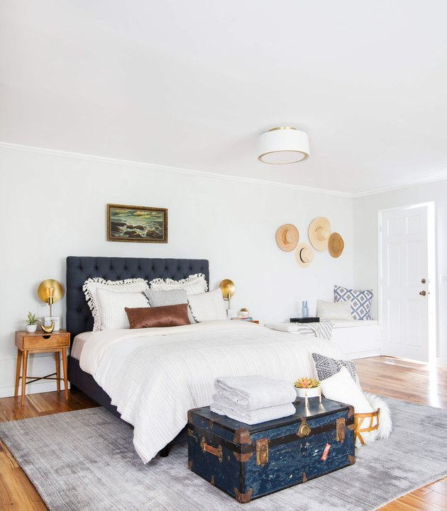 guest bedroom  idea with upholstered headboard and vintage accents
