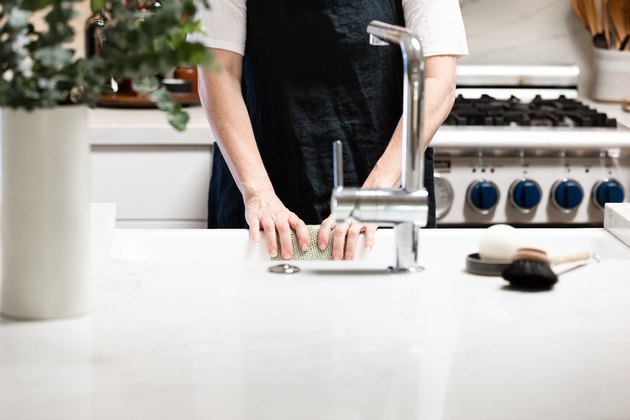 Person standing at kitchen sink