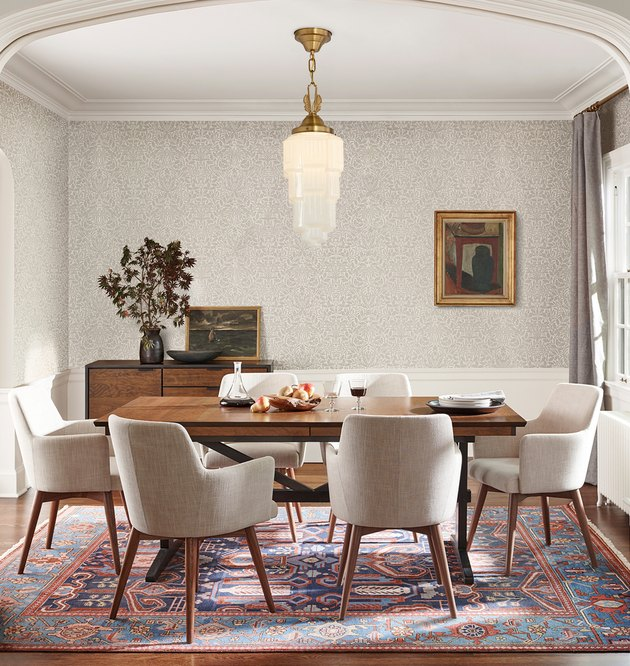 Art deco lighting in dining room with modern table and chairs