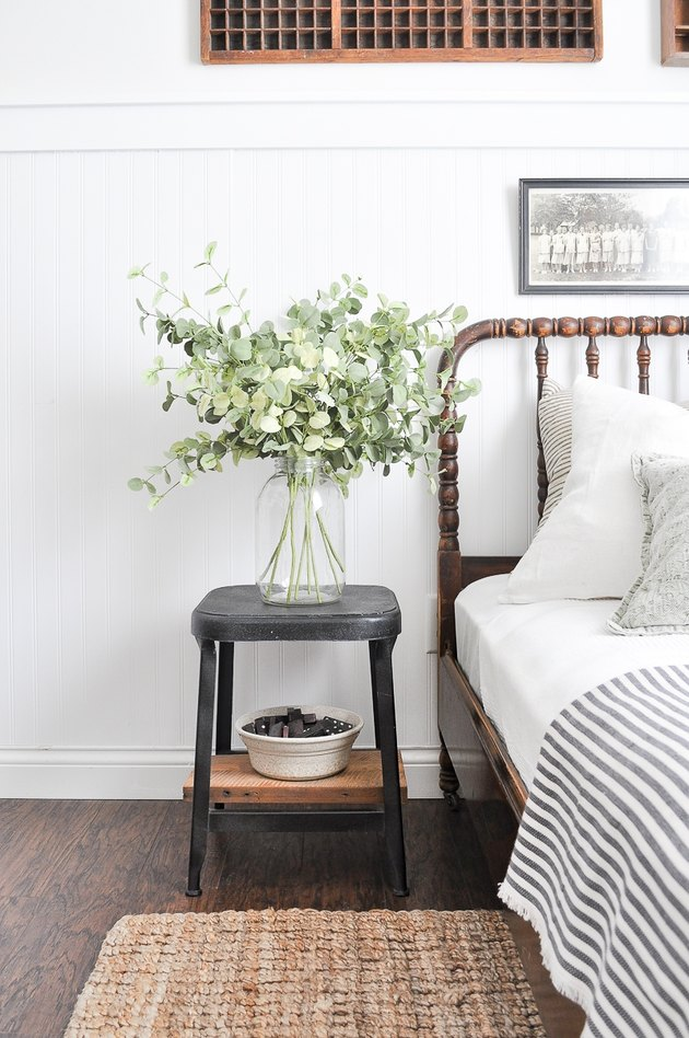 white farmhouse guest bedroom  idea with vase full of eucalyptus