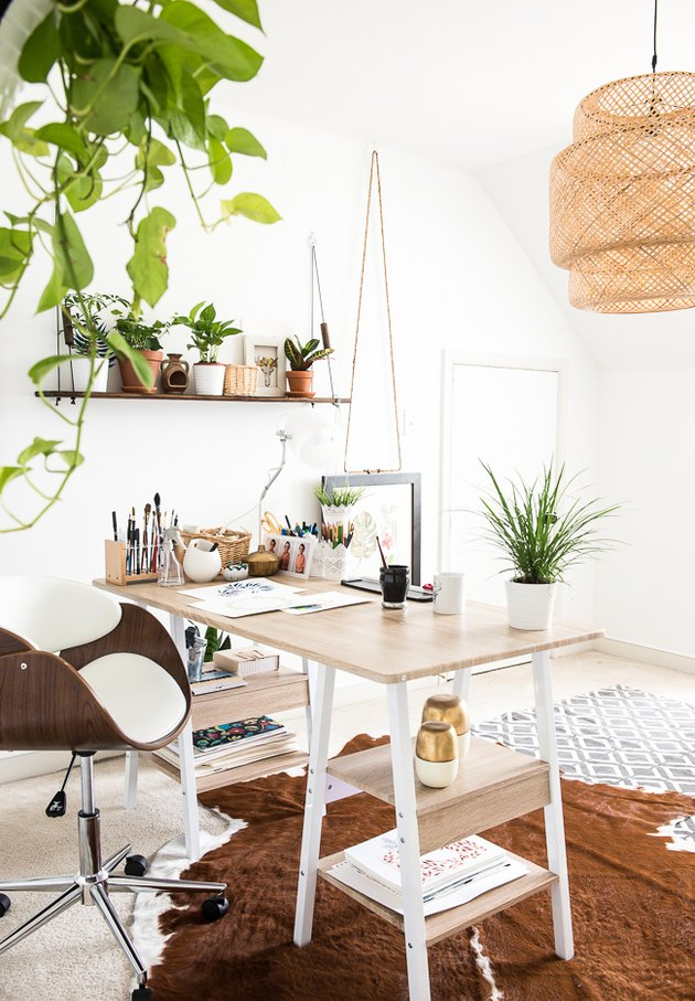 Boho office with bamboo chandelier and light wood desk