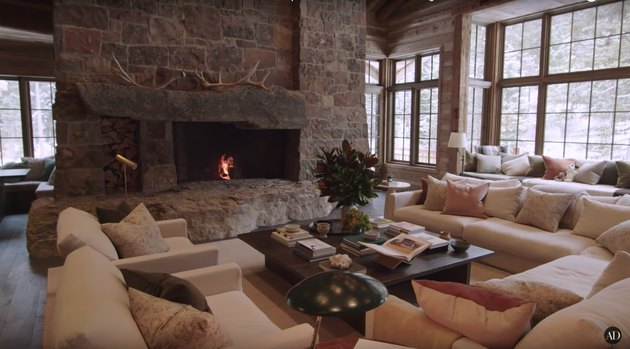 great room with fireplace and floor-to-ceiling windows
