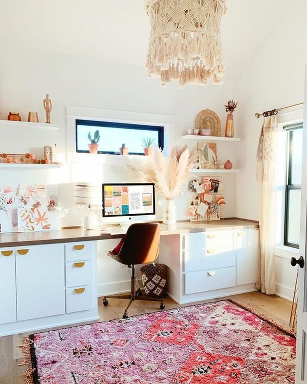 white boho office with pink rug on floor