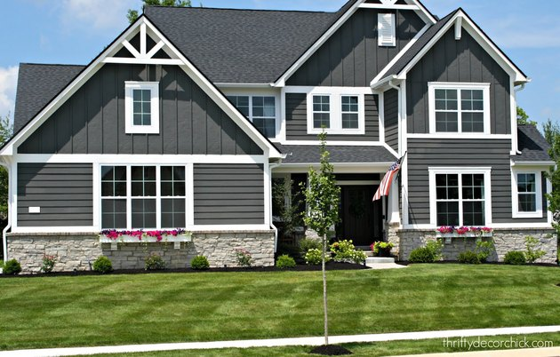 black craftsman style house with white trim