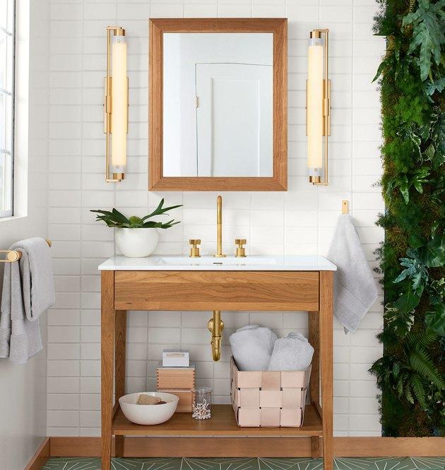 wooden open bathroom vanity in white bathroom with green tile floor