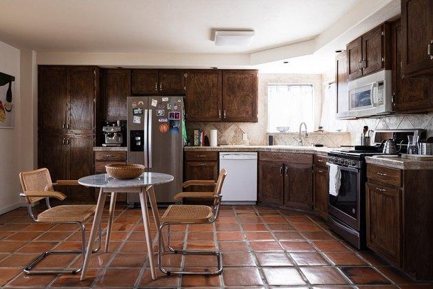kitchen with terra cotta tiles and stone backsplash