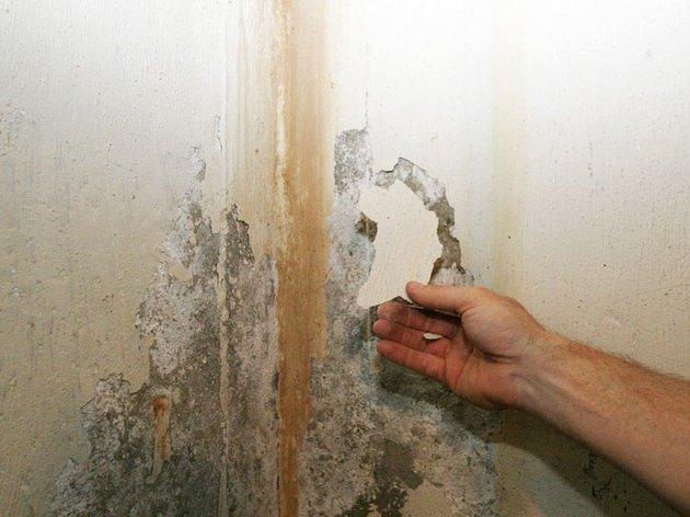 Peeling wall paint.