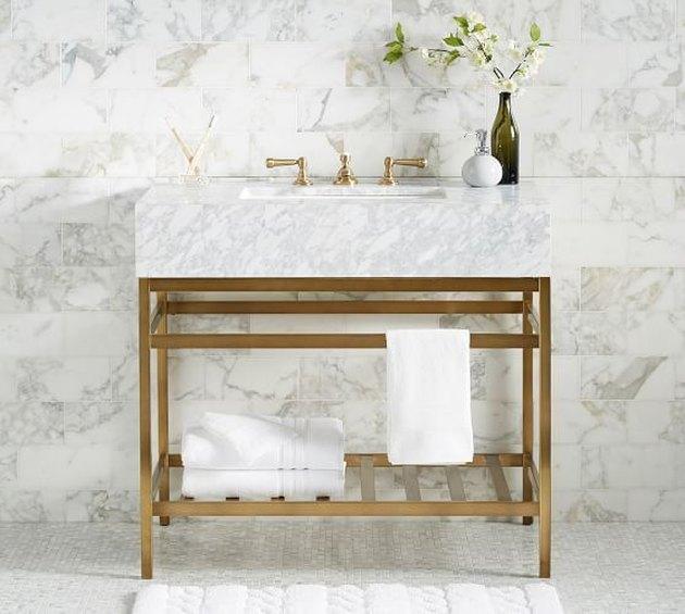 brass and marble open bathroom vanity