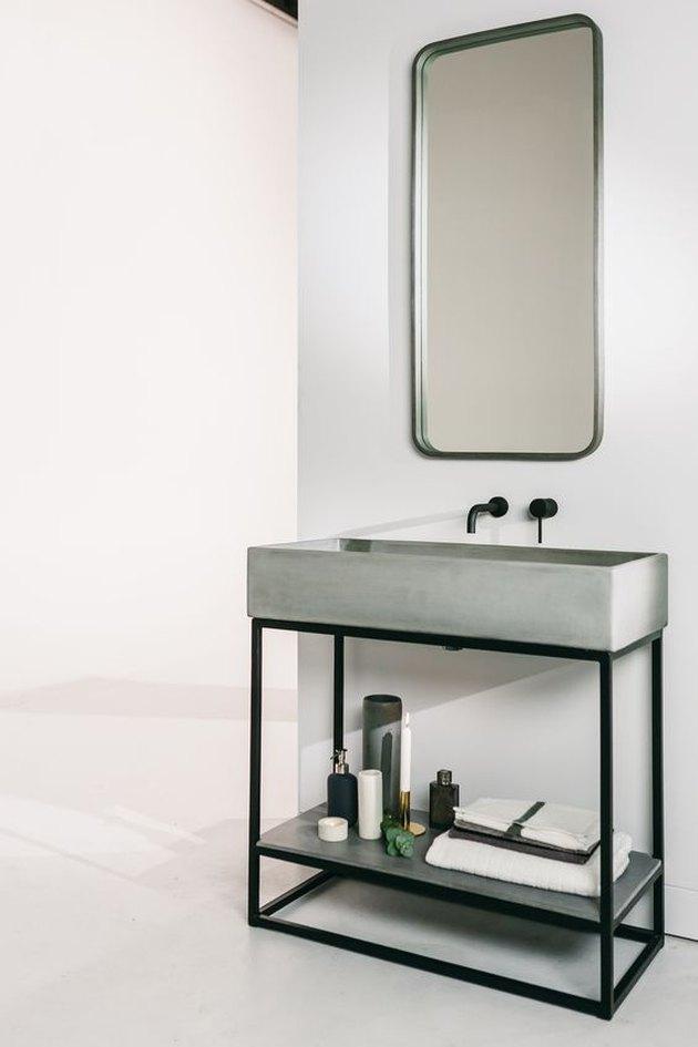 concrete and steel open bathroom vanity