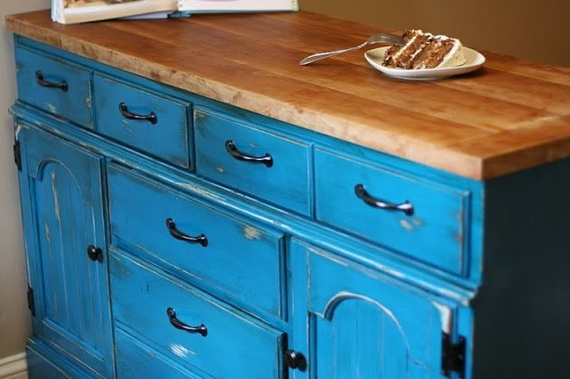 Distressed blue dresser with wood block countertop