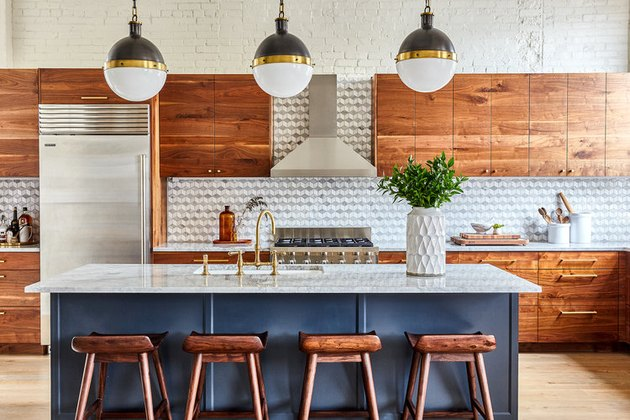 painted wood gray kitchen island with wooden stools and spherical pendant lights