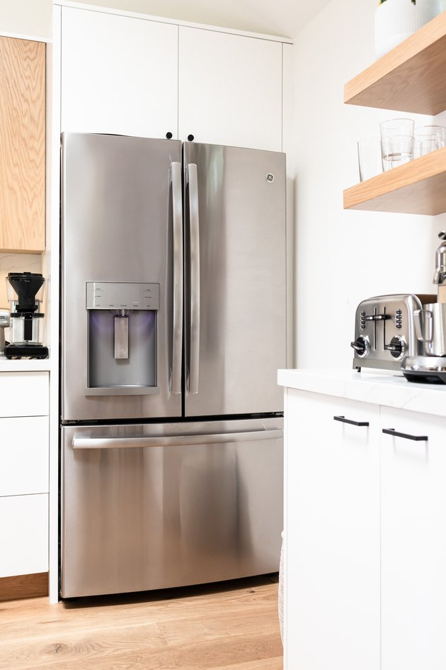 view of stainless steel fridge with water dispenser and freezer drawer