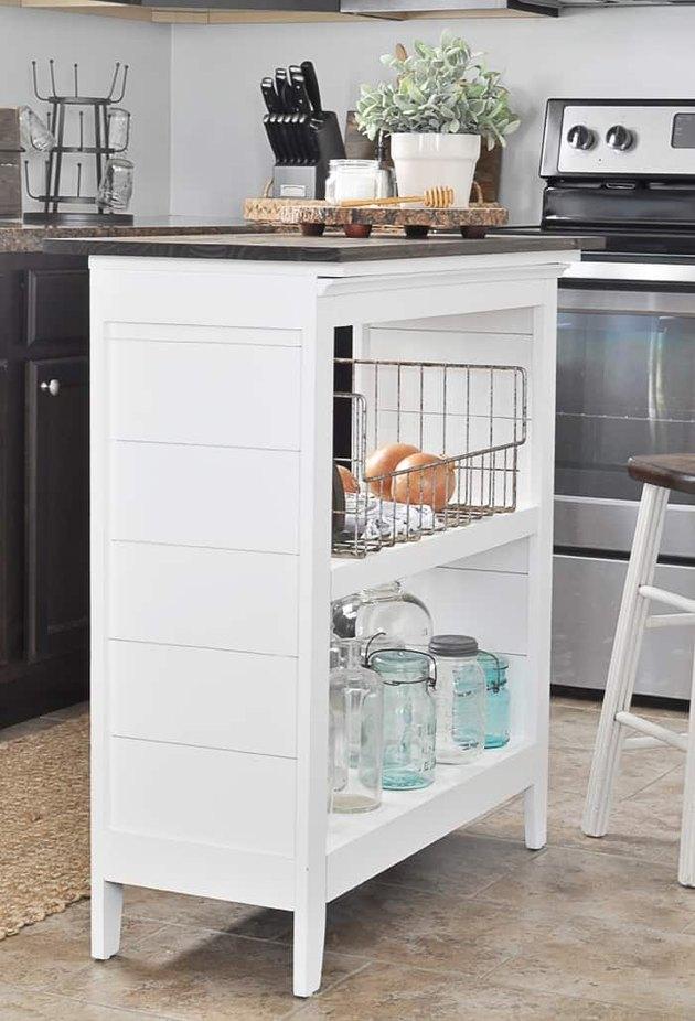 Small white bookshelf turned kitchen island on tile floors