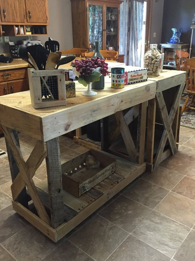 Rectangular island and bar made of wood pallets on tile floor