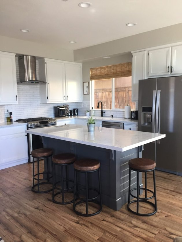 DIY kitchen island with corbels beadboard and white countertop with barstools
