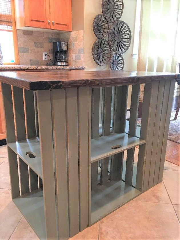 Farmhouse crate island with wood top in suburban kitchen