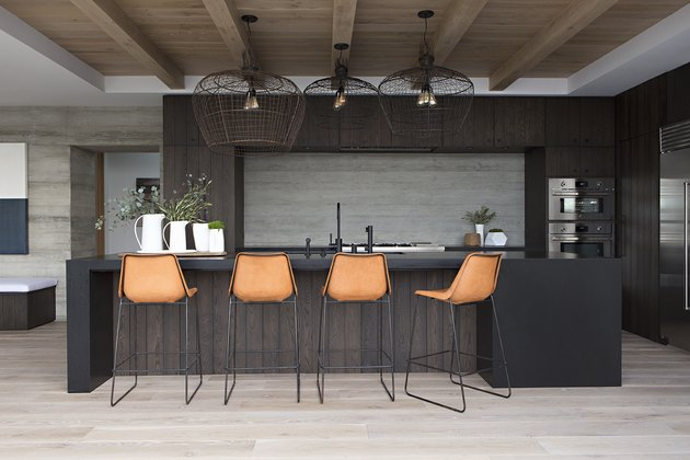 espresso kitchen island with trio of wire pendants hanging above