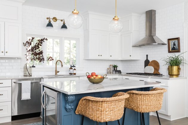 Quartzite white countertop and a blue island