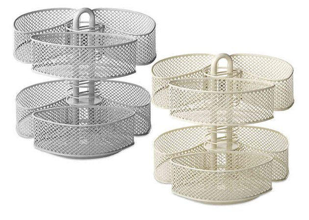 Stainless and brass finish mesh two-tiered storage carousels.