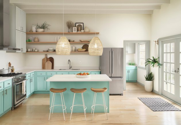 kitchen space with gray and light blue cabinets