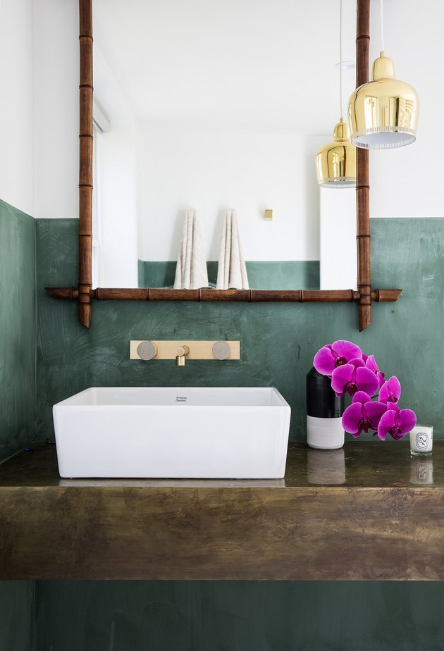 pendant lighting bathroom idea for green bathroom walls with brass pendant and wooden vanity