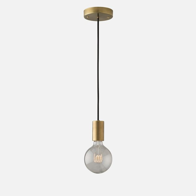 Single bulb pendant light with aged brass details
