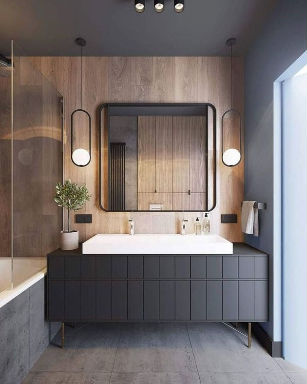 pendant lighting bathroom idea for black and brown bathroom with large mirror and hanging pendants