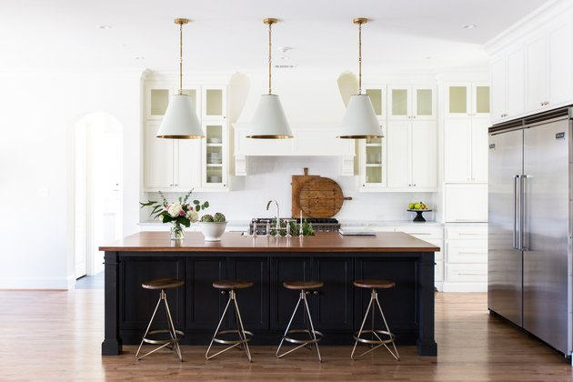 wood paneled gray kitchen island in modern white kitchen