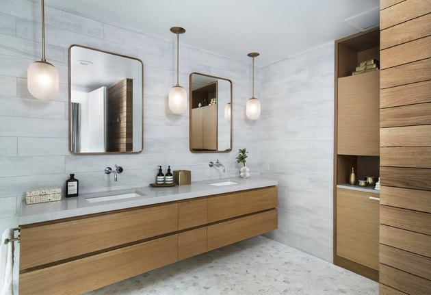 pendant lighting bathroom idea for gray bathroom with wooden vanity and shelves