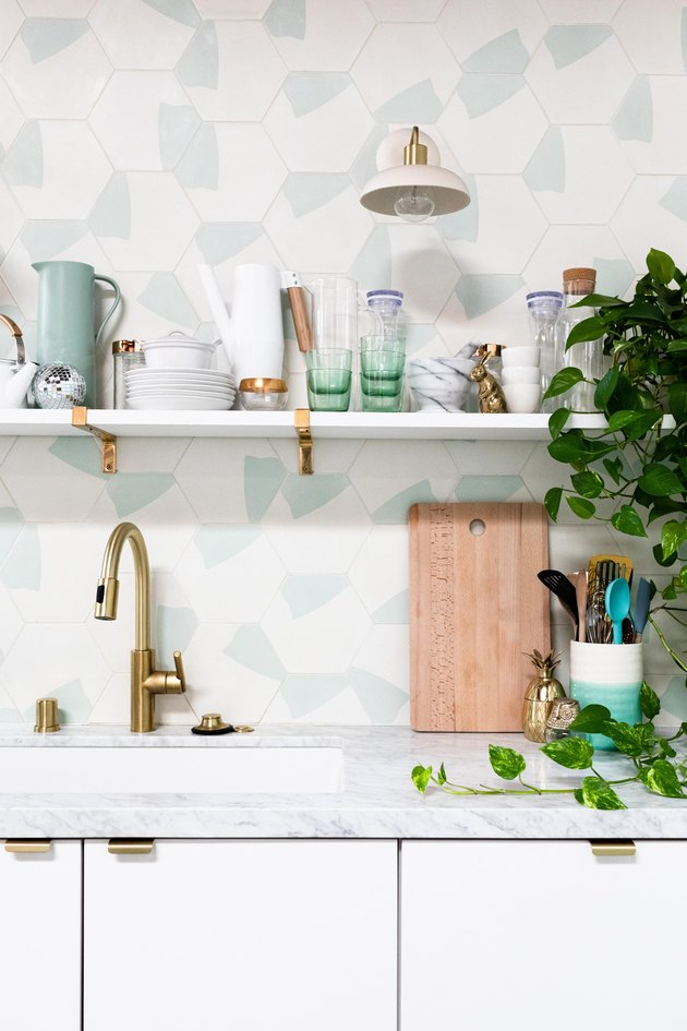 white kitchen with hexagonal tiles and undermount sink