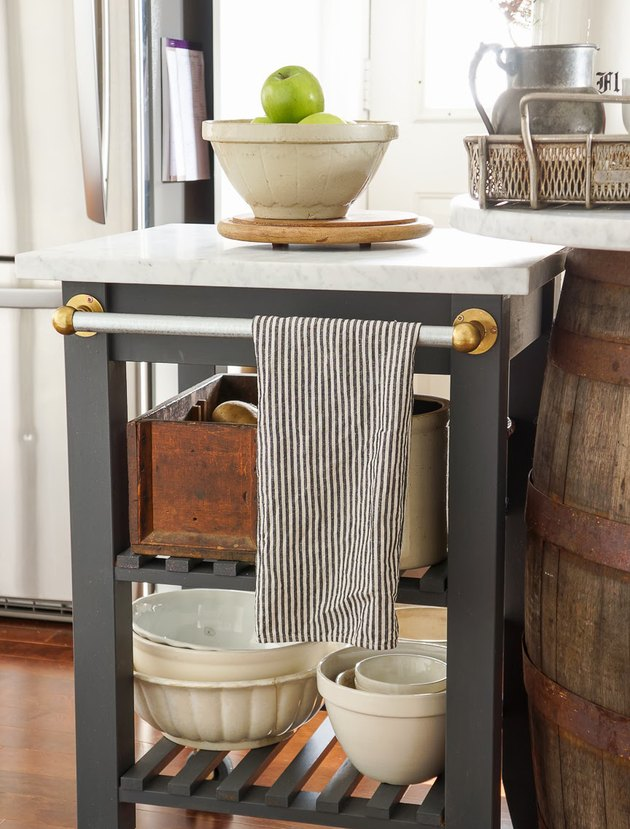 Marble IKEA kitchen island with painted black details and metal towel bar
