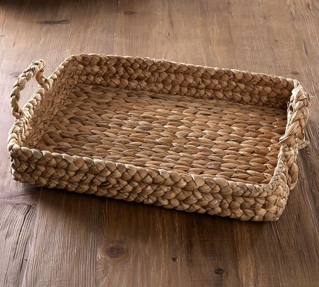 Woven decorative tray/basket with two handles