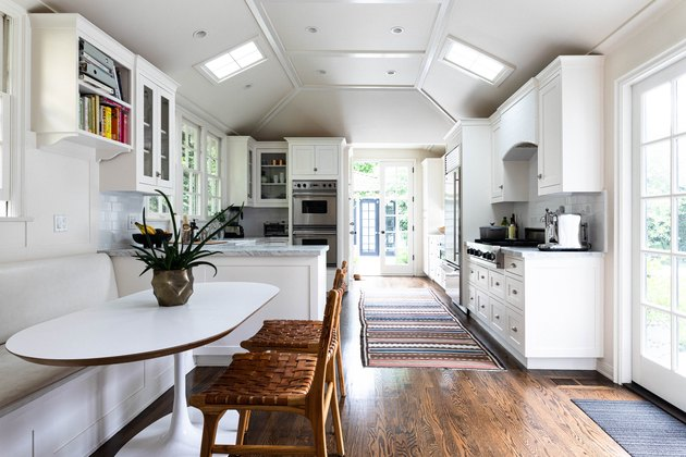 galley kitchen with built-in bench around dining table