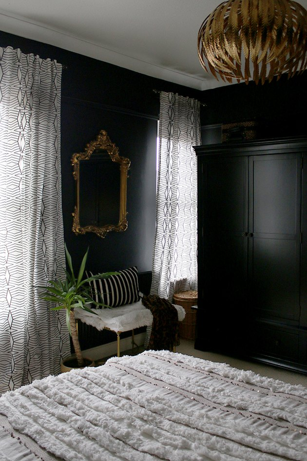 black bedroom with white and gold luxe accents