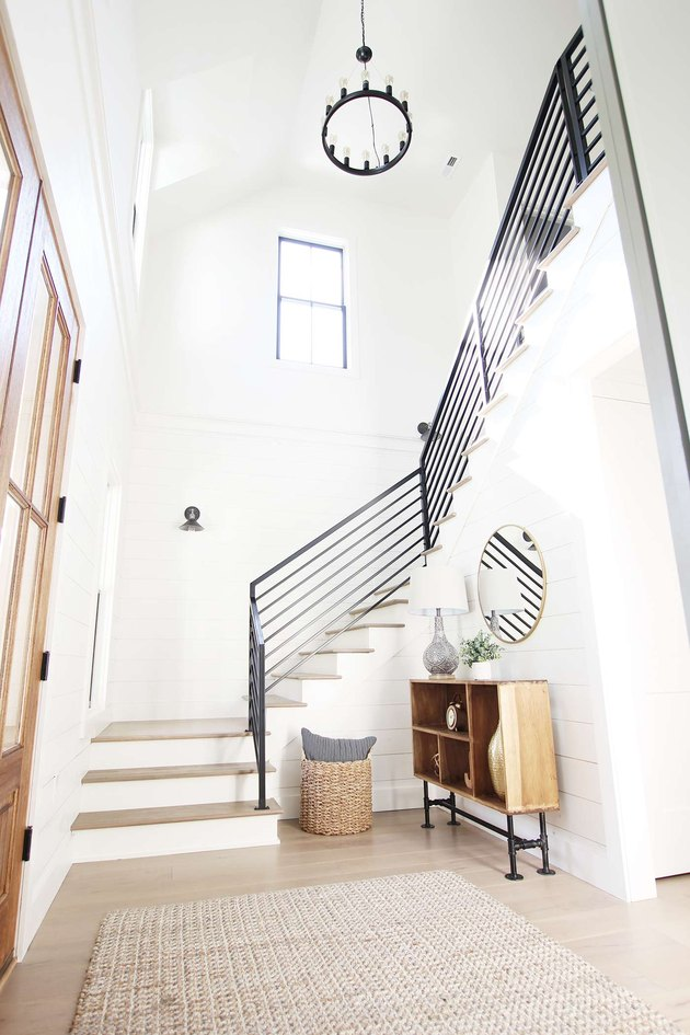 Art Deco staircase with linear railings in modern farmhouse home