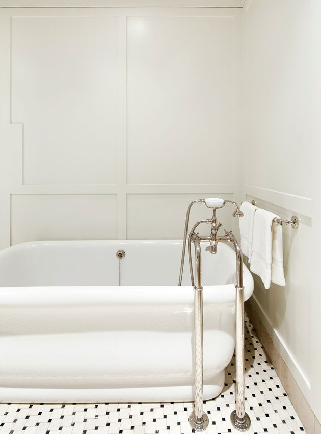 white art deco bathroom by Chango & Co. with mosaic floor tile