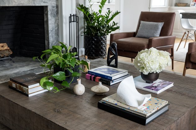 living room wooden coffee table and green accents