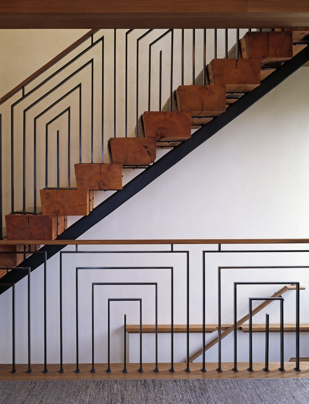 Art Deco staircase with geometric details and reclaimed wood steps